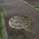 "Manhole cover at ""Canadian World"""